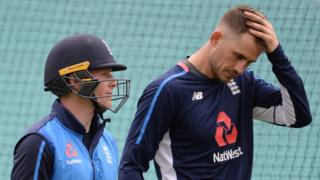 England captain Eoin Morgan (left) talks to batsman Alex Hales (right) during a training session