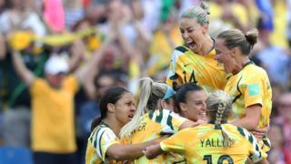 Australia celebrate scoring against Brazil