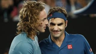 Tsitsipas and Federer at the net