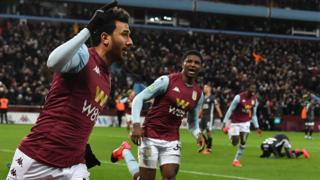 Trezeguet celebrates scoring for Aston Villa