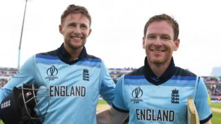 England batsmen Joe Root (left) and Eoin Morgan (right) embrace and smile as they walk off the pitch after beating Australia in the World Cup semi-final