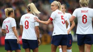 England's Steph Houghton organises a defensive wall