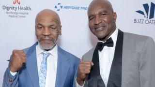 Mike Tyson (left) with Evander Holyfield