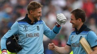 Joe Root and Eoin Morgan celebrate England's victory