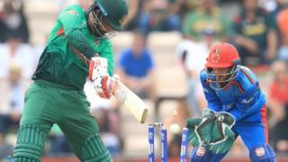 Bangladesh's Tamim Iqbal is bowled by Mohammad Nabi