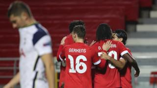 Royal Antwerp's players celebrate scoring against Tottenham in the Europa League