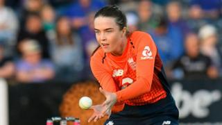 England spinner Mady Villiers shapes to catch the ball during a match against Australia