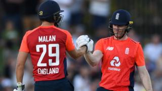 Eoin Morgan and Dawid Malan celebrate a milestone