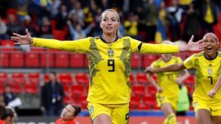 Kosovare Asllani of Sweden scores