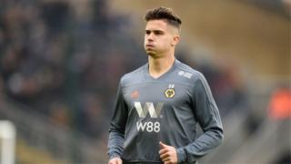 Leander Dendoncker warms up at Molineux