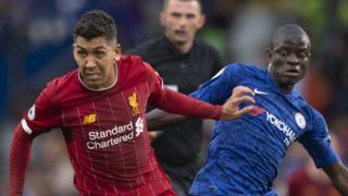 Liverpool's Roberto Firmino and Chelsea's N'Golo Kante compete for the ball in the Premier League game at Stamford Bridge