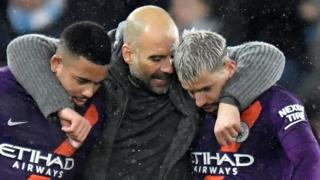 Manchester CIty manager Pep Guardiola celebrates with Gabriel Jesus and Sergio Aguero