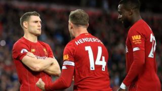 James Milner poses after scoring against Leicester