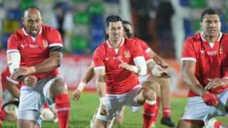 Tonga rugby players perform the Sipi Tau prior to an international Test against Georgia