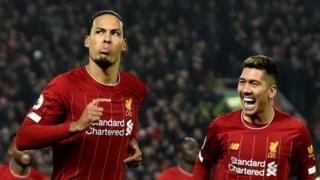 Liverpool's Virgil van Dijk (left) and Roberto Firmino