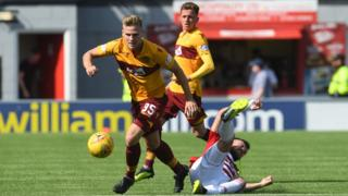Motherwell's James Scott passes Hamilton's Scott McMann