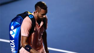 Nick Kyrgios with his head bowed as he walks off court after retiring hurt at the Mexican Open
