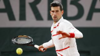 Djokovic returning the ball during a French Open game.