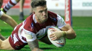 Wigan Warriors centre Oliver Gildart scores a try