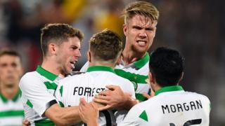 Celtic players celebrate James Forrest's goal