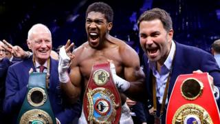 Anthony Joshua with Barry and Eddie Hearn