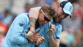 Joe Root is congratulated by Ben Stokes on his wicket