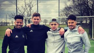 Donovan Hunt, Steven Gerrard, Billy Wingrove and Jeremy Lynch at Liverpool's Melwood training ground.