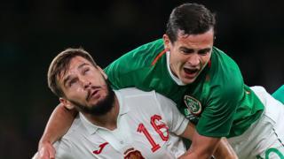 Republic of Ireland debutant Josh Cullen battles with Bulgaria's Kristiyan Malinov