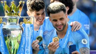 Kyle Walker and John Stones with the trophy