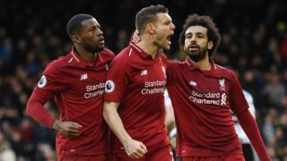 Liverpool celebrate James Milner's penalty