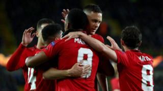Manchester United players celebrate scoring against Club Bruges