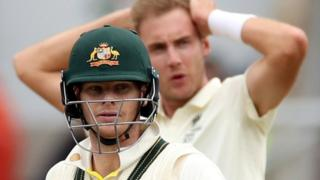 Steve Smith bats as Stuart Broad looks on
