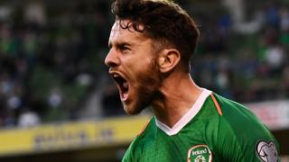 Robbie Brady celebrates his late goal against Gibraltar