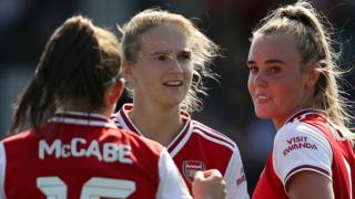 Arsenal's Jill Roord with team mates Vivianne Miedema and Katie McCabe