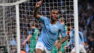 Raheem Sterling celebrates scoring Manchester City's third goal