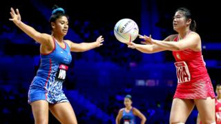 Samoa's Afi Lafaiali'i-Sapolu (left) and Singapore's Kimberly Lim