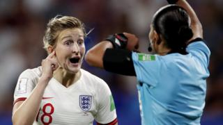 Ellen White with referee at World Cup
