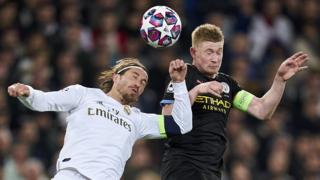 Real Madrid's Sergio Ramos (left) and Manchester City's Kevin de Bruyne (right) jump to try to head the ball