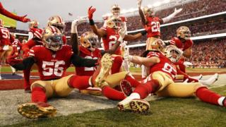 The San Francisco 49ers celebrate against Green Bay Packers