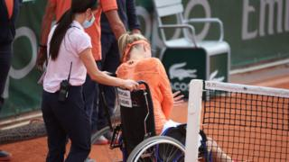 Kiki Bertens leaves court in wheelchair