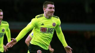 John Fleck celebrates Sheffield United's equaliser at Arsenal