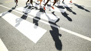 Runners in shadow