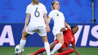 Ashley Lawrence vies with Canada defender Shelina Zadorsky