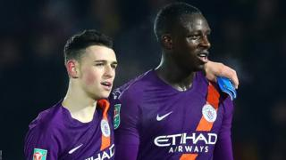 Phil Foden of Manchester City embraces team-mate Benjamin Mendy