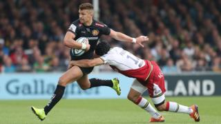 Exeter's Henry Slade is tackled by Northampton's Piers Francis
