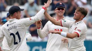 Essex bowler Adam Beard (right) celebrates taking a wicket against Somerset