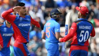 Mujeeb celebrates dismissing Rohit Sharma
