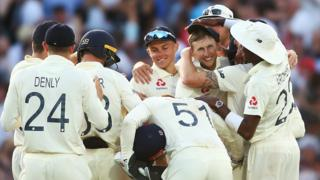 Root celebrates his catch