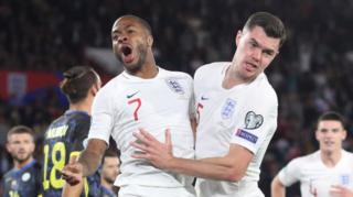 Michael Keane and Raheem Sterling