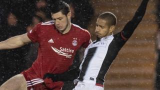 Aberdeen's Scott McKenna and St Mirren's Simeon Jackson